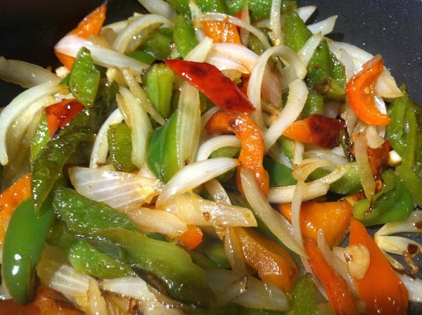 NOW ADD SLICED ONIONS, GARLIC N  CRUSHD RED PEPPER (if usiNg) SAUTÉ FOR...