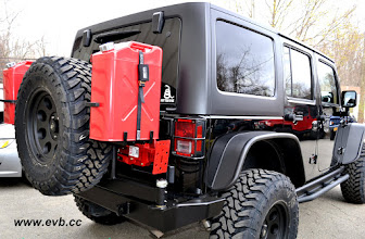 Photo: Garvin rear bumper with Spare tire mount and Jerry Can Mounts, Hi-Lift Jack, 35x12.50x17 Toyo Open Country M/Ts, ProComp 7069 Rims