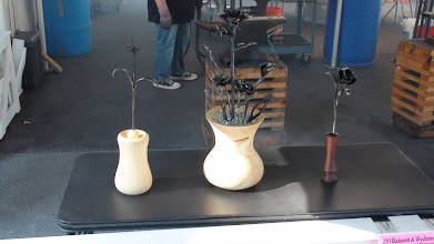 Photo: MCW & Blacksmith Collaborative Raffle Large Ash Vase - Tim Aley Medium Ash Vase - Bert Bleckwenn Black Walnut Bud Vase - Bert Bleckwenn Iron Flora - Blacksmiths