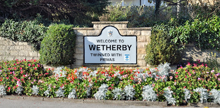 Photo: At the south end of the entrance to Wetherby. Wetherby in bloom do a fantastic job.