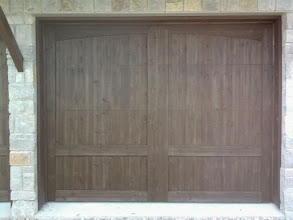 Photo: Custom Wood Doors with a customer selected Cedar overlay on the front of the door.