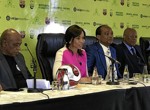 Mining magnate Patrice Motsepe with his wife Precious, flanked by Tokyo Sexwale, left, and Jeff Radebe.