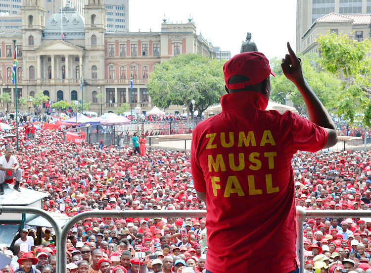 Julius Malema of the EFF addresses crowd at Church Square during the anti Jacob Zuma march by opposition parties to the Union Buildings in Pretoria, South Africa on 12 April 2017.