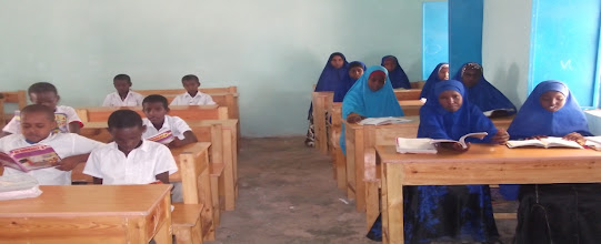Photo: A new development in big towns in Somalia; we are seeing more and more an equal nr of boys and girls in classrooms. In Puntland, the % of girls in primary school was 27% in 2010. in 2013 that has risen to 48%!!  But is there also equal participation?