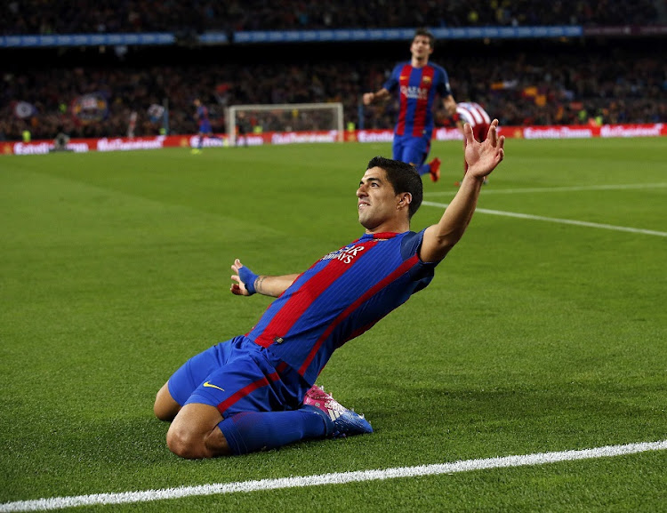 Barcelona's Luis Suarez celebrates after scoring their first goal  in the Spanish King's Cup semifinal. Picture: REUTERS/ALBERT GEA