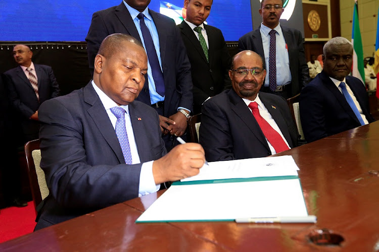 Central African Republic President Faustin-Archange Touadera signs a peace deal between the Central African Republic government and 14 armed groups following two weeks of talks in the Sudanese capital, Khartoum, Sudan, February 5, 2019. Picture: REUTERS/MOHAMED NURDLDIN ABDALLAH