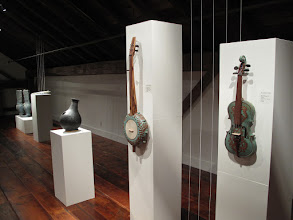 "Photo: Instruments by Brian Ransom, Frank Giorgini and Rob Mangum. Exhibition of ceramic musical instruments at The Bascom Arts Center in Highlands, NC. The exhibit, curated by Barry Hall and Brian Ransom, features musical instruments created by ceramic artists from around the world, as featured in the book ""From Mud to Music"" by Barry Hall."