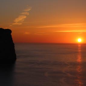 by Tonia Hernandez - Landscapes Sunsets & Sunrises ( lighthouse sunset ocean travel travel )