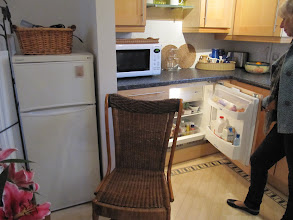 Photo: Small build in and larger free-standing fridge, director's flat