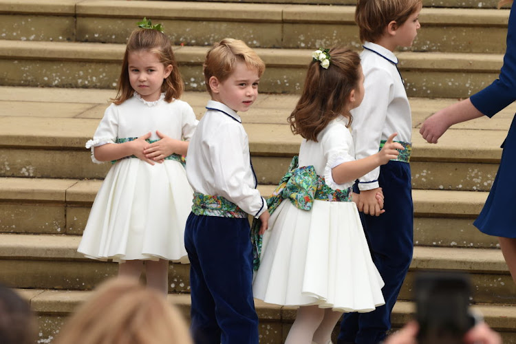 The bridesmaids and page boys including Prince George of Cambridge and Princess Charlotte of Cambridge arrive at St George's Chapel in Windsor Castle.