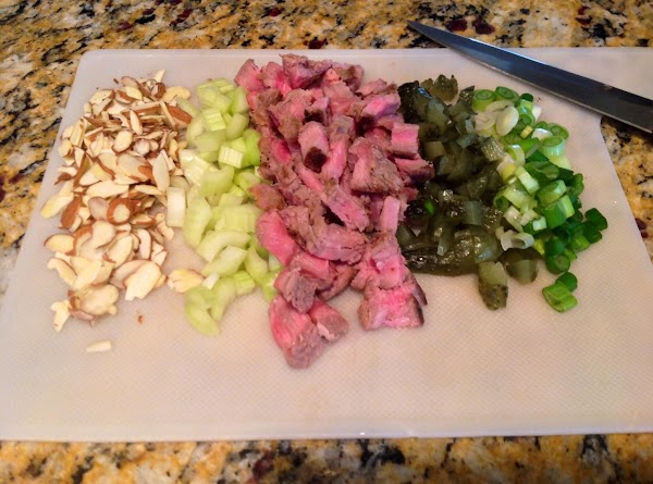 Chop steak, veggies and pickles.  Add slivered almonds to mix.