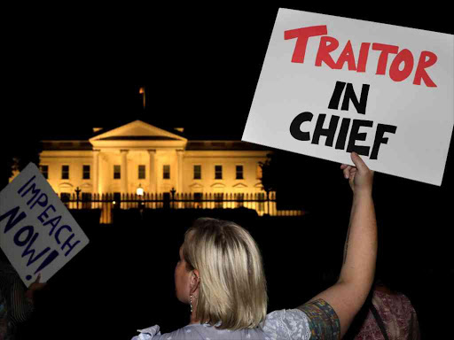 Protesters rally outside the White House in Washington, US, after President Donald Trump's return from Helsinki, Finland, July 16, 2018. /REUTERS
