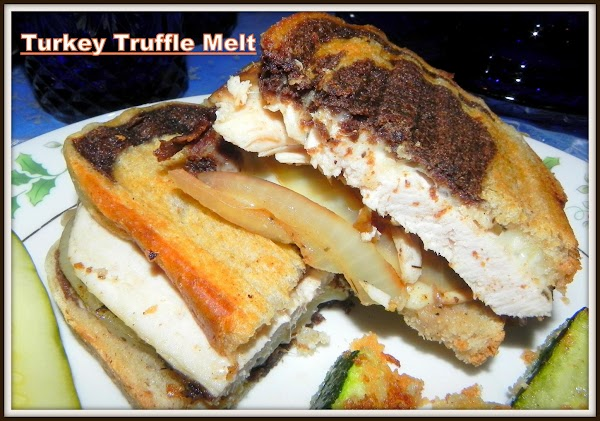 Grill sandwich till cheese is melted.