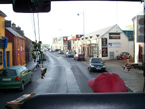 Photo: view out the bus's front window (note all the leprechauns hanging from the mirror)