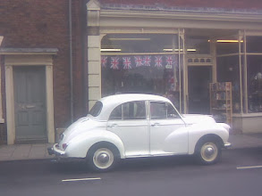 Photo: As luck would have it, an early 60's antique Moggy parked outside Clare Boams on North St.   I can't remember too many white ones. The Police used black, and later sky blue for their Pandas.