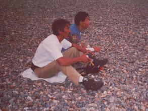 Photo: Herman and Akiat check the spool machine
