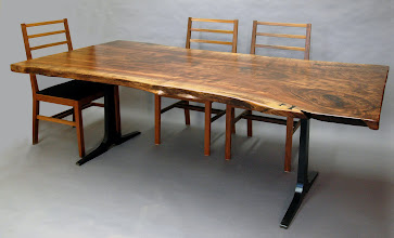 Photo: http://dorsetcustomfurniture.blogspot.com/2012/02/claro-walnut-slab-dining-table.html