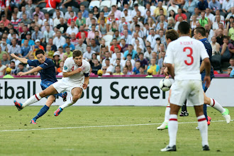 Photo: Samir Nasri of France scores their first goal past Steven Gerrard of England during the UEFA EURO 2012 group D match between France and England at Donbass Arena on June 11, 2012 in Donetsk, Ukraine.