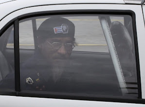 Photo: Street entertainer 'Omar' is driven away in a police car after being arrested in Havana October 6, 2010. After 20 years of making his living unlawfully by dressing up like a Cuban revolutionary and posing for tips for tourist photos in Old Havana, 64-year-old Omar is now hoping he can make a legal career of it. He wants to get one of 250,000 licenses for small businesses the Cuban government plans to start issuing this month so he can work without fear of official reprisals.  REUTERS/Desmond Boylan (CUBA - Tags: SOCIETY BUSINESS EMPLOYMENT CRIME LAW)