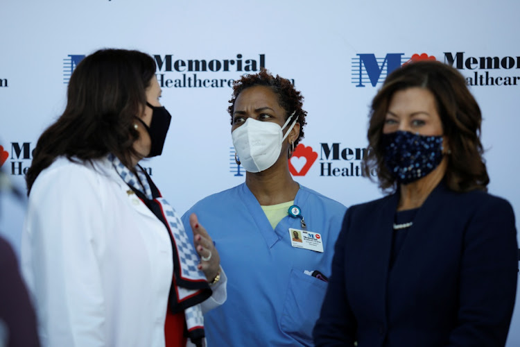 Health workers chat during a press conference before some workers of the staff receiving the Pfizer-BioNTech Covid-19 vaccine at Memorial Healthcare System facility in Miramar, Florida. Picture: REUTERS/Marco Bello