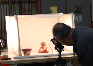 Photo: It takes a lot of work to make the club run, here Hal Burdett takes a picture of the show and tell items.