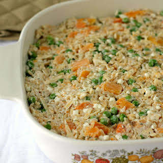 Brown Rice And Vegetable Casserole With Cheese.