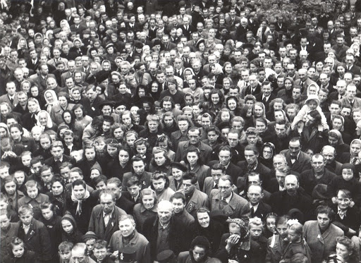 A crowd of people outside the City Hall in Nové Straseci expected news about the end of the war