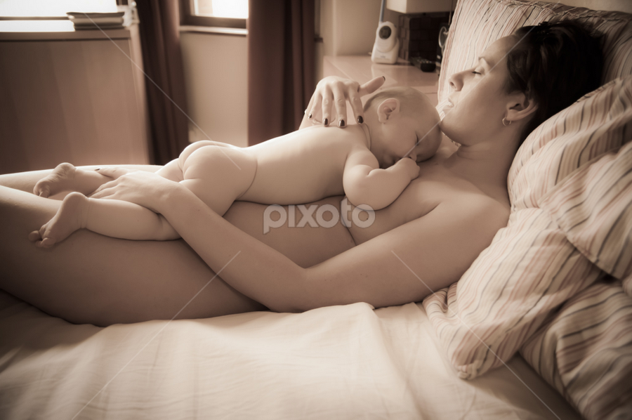 Afternoon Nap by Ian Cartwright - People Maternity ( mother, naked, bed, baby, rest, sleep )