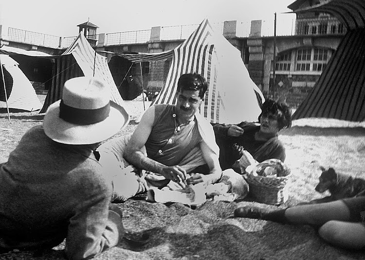 "Coco Chanel and her lover Arthur ""Boy"" Capel (mustache) with Constent Say on the beach in Saint Jean de Luz in 1917."