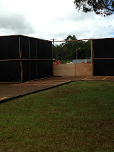 Photo: The area in front of our school - notice that they left some areas free of the black dust barrier and they put up 4' walls instead.  This is so we can see what they are working on.