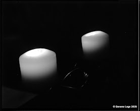 Photo: Two candles.  4x5 view camera.  f/5.6, 19 sec, paper negative and yellow filter. Swing and down-shift of lens.