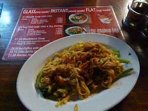 Photo: Sihanoukville - GST GH 4usd single fan room w BR/WC/CTV, Lok lak for lunch, Golden lions ringroad, Ochheuteal beach and street with yellow signs, Utopia noodles for 1USD from noodle box outside