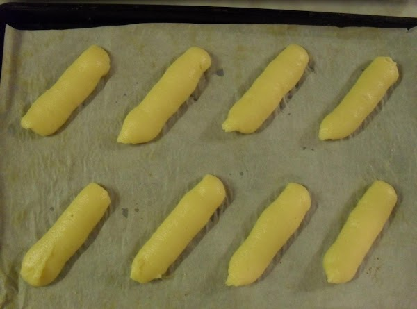 Spoon batter into a pastry bag with a 3/4 inch opening(no tip). Squeeze out...
