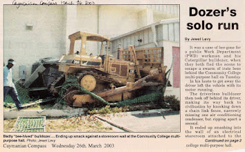 Photo: 2003 March Runaway driverless bulldozer crashes into air-conditioning units by the Community College of the Cayman Islands multi-purpose hall,  after the driver was attacked by bees and jumped off the bulldozer. Caymanian Compass March 26, 2003