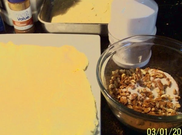 On your cutting board, unroll the tube of crescent dough into a rectangle,  press and...