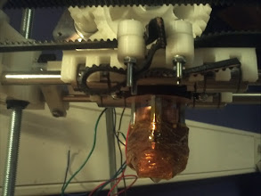 Photo: Extruder on place with isolation, GT3 Belt that was way to long I.M.O. and in the left corner, you can se the black-tape that i wrapped around the M8 Bolt, a messy way of doing it i think. Will use glue-gun on that later on i think..