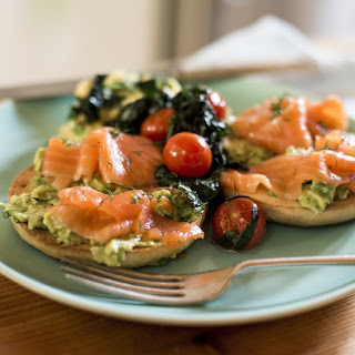 Smoked Salmon Bagel, Crushed Avocado, Tomatoes, Spinach and Scrambled Egg.