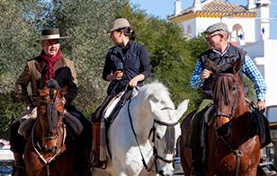 Homens a cavalo em El Rocío