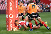Shaun Reynolds of the Xerox Golden Lions scores during the Currie Cup match at Emirates Airline Park on September 08, 2018 in Johannesburg, South Africa.