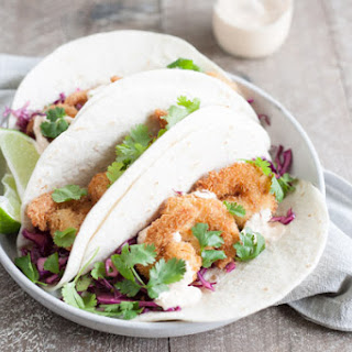 Coconut Shrimp Tacos with Cilantro Cabbage Slaw.