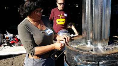 Photo: Attaching handles to the Jolly Roger Oven.
