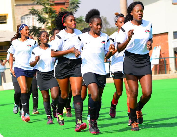 Kenyan women's hockey players led by Gilly Okumu warm up prior to their friendly match against Sports Authority of India at SIKH Union
