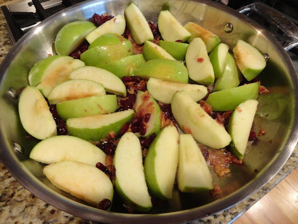 In skillet, melt butter and cook apples, cranberries and bacon bits over low heat...