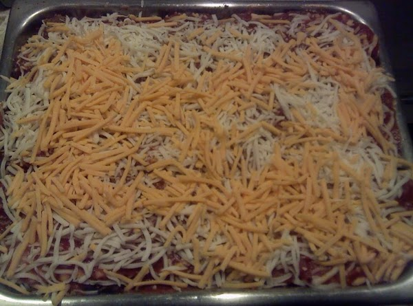 Top with a final layer of noodles, the last of the sauce, some Mozzarella...
