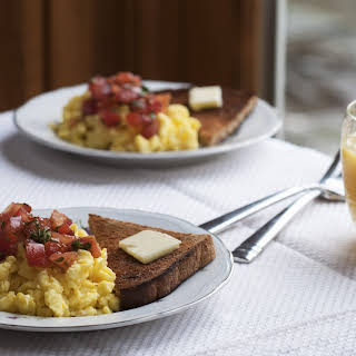 Soft Scrambled Eggs with Mediterranean Tomato Topping.