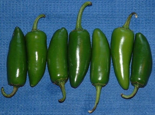 Remove the stems from the jalapeños and cut each in half lengthwise. Scoop out...