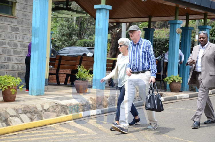 Dutch Tycoon's sister accompanied by the husband arrives at the Chiromo mortuary./DOUGLAS OKIDDY