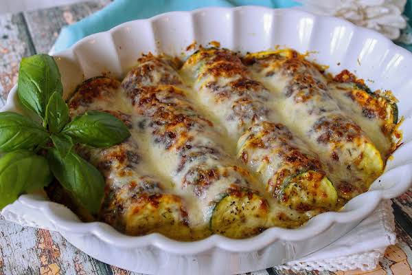 Summer Squash Cheesy Bake In A Dish With Melted Cheese.