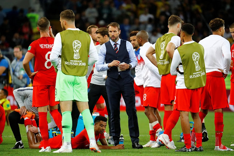 England manager Gareth Southgate with the players before the penalty shootout.