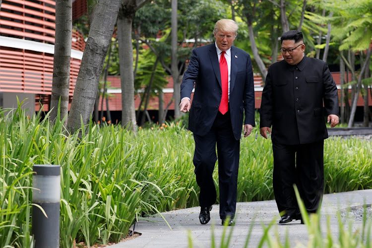 US President Donald Trump and North Korean leader Kim Jong-un walk after lunch at the Capella Hotel on Sentosa island in Singapore on June 12 2018. Picture: REUTERS/JONATHAN ERNST